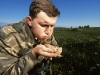 Bielorussian ornithologist with aquatic warbler